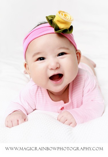 laughing baby for her photo session in London